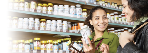 2 women looking at natural health product supplements